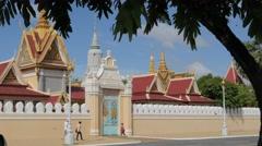 People walking pat Royal Palace,Phnom Penh,Cambodia - stock footage