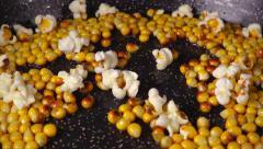 Exploding popcorn, slow motion Stock Footage