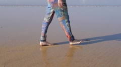 Woman leg going on the beach, morocco Stock Footage