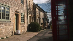 Cotswolds England telephone box in rural england - stock footage