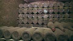 Stock Video Footage of Old bottle of wine in a cellar