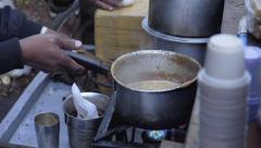 Man making a chai tea in India Stock Footage