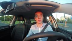 Stock Video Footage of young handsome man drives modern car and pays attention at traffic