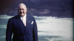 1949: Proud executive visiting the ocean on road trip across the continent. DEL - stock footage