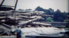 1949: Timber logs splashing water process man stick overalls for safety. Stock Footage