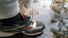 Crackling ice under feet, in the forrest Stock Footage