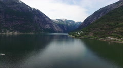 Small boat passing through Hardanger fjord in Norway. Stock Footage