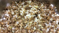 Stock Video Footage of Diced mushrooms and onions, drying up, after cleansing, at a restaurant kitch