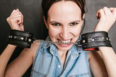 Arrest and jail. Criminal woman prisoner girl in handcuffs Stock Photos
