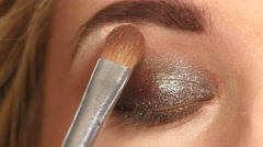 Makeup. Make-up. Eyeshadows. Eye shadow brush. Close up Stock Footage