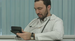 Sinister bearded doctor with a calculator. calculation of price Stock Footage