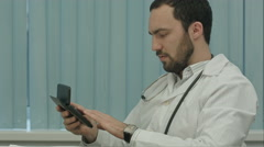 Bearded doctor with a calculator. make calculations of price and satisfied of it Stock Footage