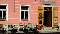 View of the restaurant with outdoor seating - flowers in the box by the windows Stock Footage