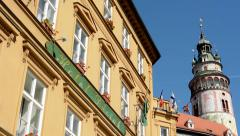 View of historical building with shelter and flags - tall tower opposite Stock Footage