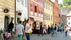 View of the outdoor seating in the historical street - people eat  Stock Footage