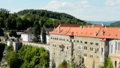 view of many buldings of historical city - forest with hill - castle - stock footage