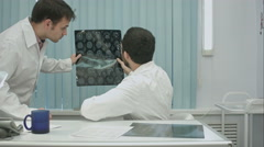 Tutor doctor help intern with x-ray Stock Footage