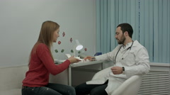 Male doctor in clinic giving reccomendation to patient about pills Stock Footage