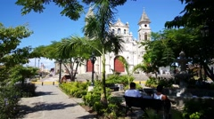Guadalupe Church with a small park with local people on a bench Stock Footage