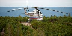 Siberia, Russia - August 27, 2013: Helicopter MI-8 landed on the mountian. - stock photo