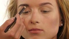 Woman draw beauty shape of eyebrows using cosmetic brush, Close up Stock Footage