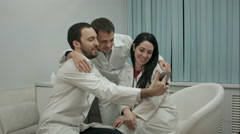 Team of doctors taking selfie all together in a medical office Stock Footage