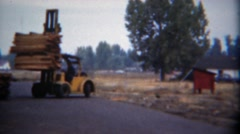 1949: Modern yellow forklift slowly moving lumber woodpile.  TITUSVILLE, Stock Footage