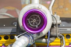 Turbo charger on race car engine - stock photo