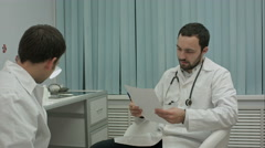 Mentor doctor isn't happy with results of medical practice of intern - stock footage