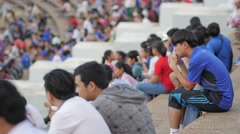 Boy eating sandwhich in stadium,Phnom Penh,Cambodia Stock Footage
