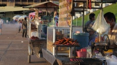 Barbeque food stalls in Olympic stadium,Phnom Penh,Cambodia Stock Footage