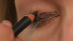 Stock Video Footage of Eye makeup woman applying eyeshadow powder, Close up. Slow motion