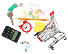 Shopping cart with stationery and keys - stock photo