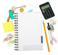 Open notebook with stationery - stock photo