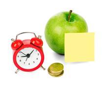 Fresh apple with alarm clock - stock photo