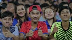 Young people hold thumbs up before match,Phnom Penh,Cambodia Stock Footage