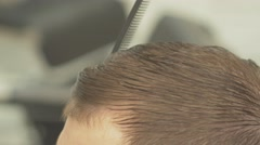 Stock Video Footage of the Barber brushed a head. Close Up