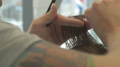 This video is about haircut in a barbershop. Close Up. 4k Stock Footage