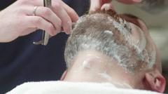 Shaving beard / neck /  cheeks / man. Barbershop service - stock footage