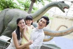 Stock Photo of Young family in museum of natural history