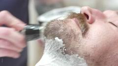 Shaving the beard. Barbershop service 4K Stock Footage