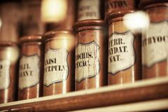 Vintage medications in small bottles Stock Photos