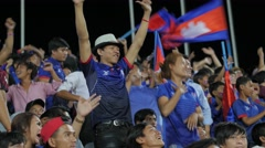 Stock Video Footage of Fans cheer as a goal has been made at soccer match,Phnom Penh,Cambodia