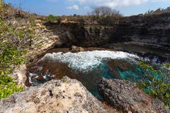 Tunnel crater coastline at Nusa Penida island Stock Photos