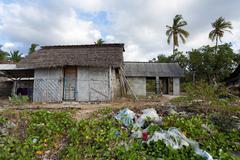 indonesian house - shack on beach - stock photo
