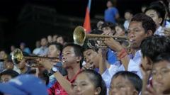 Fans play trumpet at football match,Phnom Penh,Cambodia - stock footage