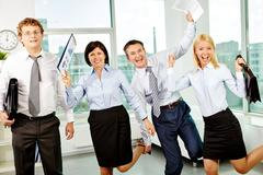 Ecstatic office workers Stock Photos
