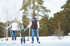 Family on skating-rink - stock photo