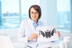 Psychologist at workplace - stock photo