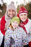 Family in winter-wear Stock Photos